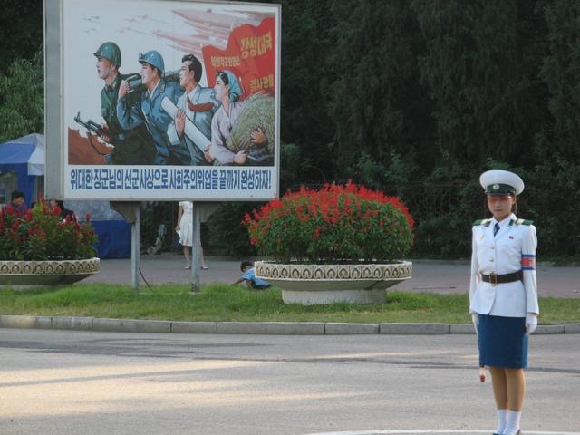 cxa.  1 PTG and a propaganda poster >--->