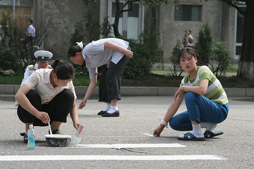 Off-Duty Trafficgirls Painting A Crosswalk