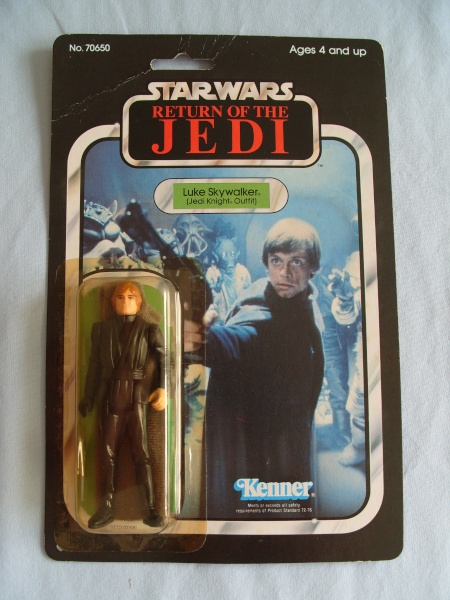 Jedi luke 65 back, green saber with snap cape visable in box. Tj_65-26